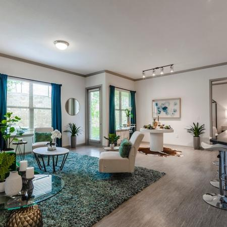 Vast Living Room Space | Apartments In Garland TX | The Mansions at Spring Creek
