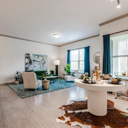 Residents Having Dinner in the Dining Room | Apartments In Garland TX | The Mansions at Spring Creek