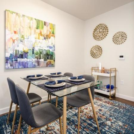 Dining area with modern art on the wall at Chelmsford Massachusetts Apartments | Mill and 3 Apartments