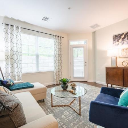 Living room with large windows at Chelmsford Massachusetts Apartments for Rent | Mill and 3 Apartments