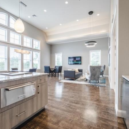 Open concept living area with wood plank style floor and stainless steel appliances | Chelmsford Massachusetts Apartments | Mill and 3 Apartments