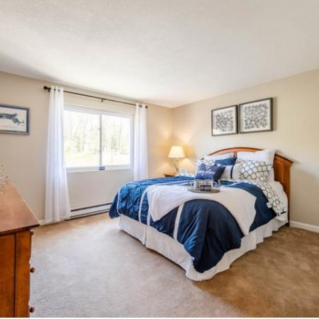 Light-filled bedroom in an apartment at Princeton Reserve in Dracut, MA.