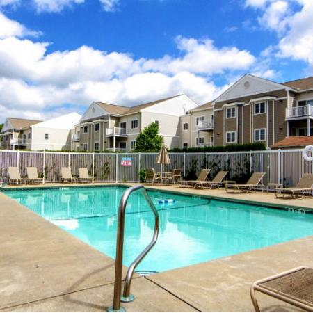 Swimming pool and sun deck at Princeton Reserve, Lowell, MA apartments.