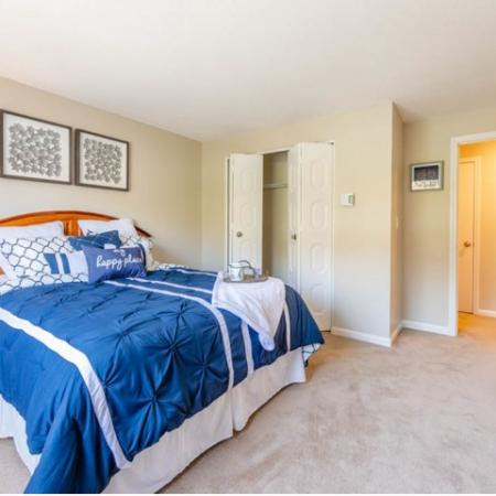 Bedroom  and closet with door opening into hall in apartment at Princeton Preserve in Dracut, MA.