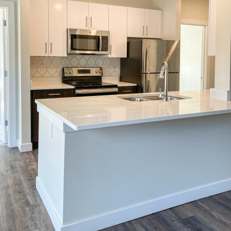 Kitchen - white-on-white cabinetry in annex apartment at Dover Apartments in Dover, NH.