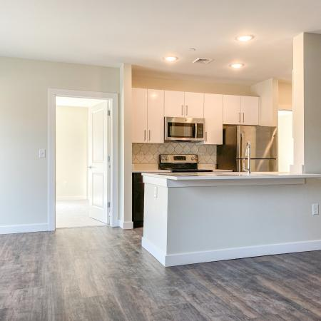 Plank-style flooring in living area and kitchen in annex apartment at Dover Apartments in Dover, NH.