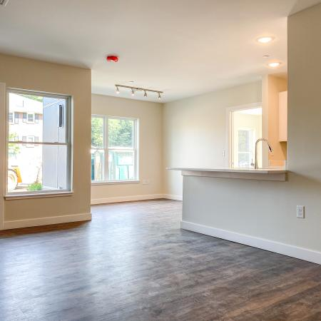 Plank-style flooring, large windows, airy space  in annex apartment at Dover Apartments in Dover, NH.