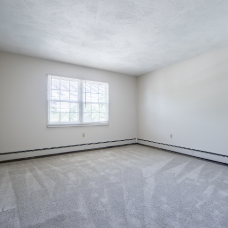 Spacious living area with multiple windows at Princeton Crossing | Apartment for Rent in Salem, MA