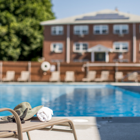 Lounge chair and pool at Princeton Crossing | Apartments for Rent in Salem, MA