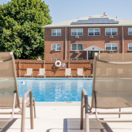 Lounge chairs at poolside at Princeton Crossing | Apartments for Rent in Salem, MA