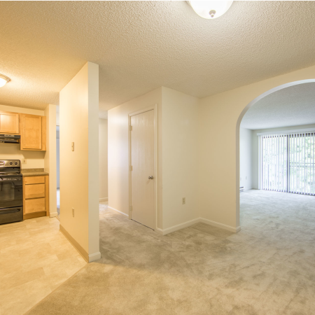 Living area featuring archway between dining and living room | Princeton Place | Apartments For Rent Near Worcester MA