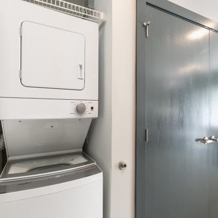 Stack-able washer and dryer in studio apartment.