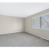 Large Bedroom & Window | Apartments for Rent in Woodridge, IL | The Townhomes at Highcrest