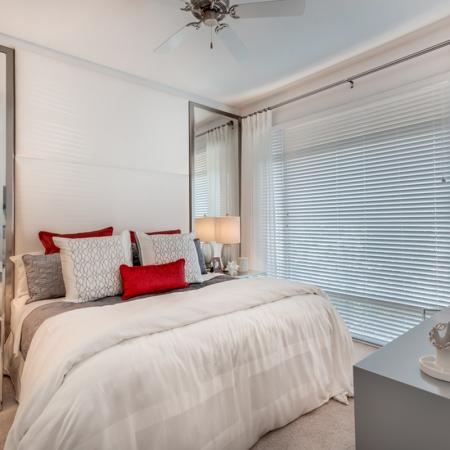 Image of furnished bedroom in apartment with silver night stands