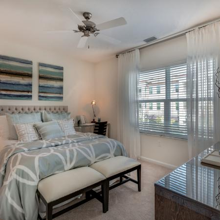 Image of furnished bedroom with teal accent comforter and silver night stands