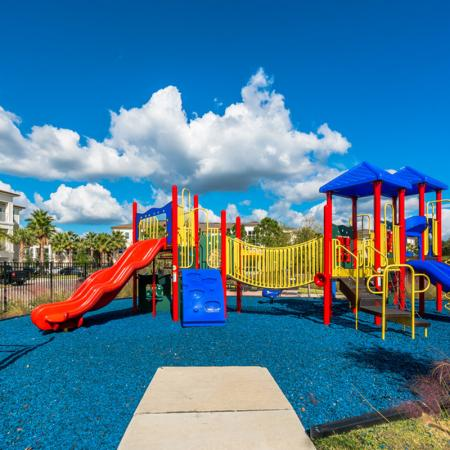 Image of playground with blue mulch at The Marq Highland Park