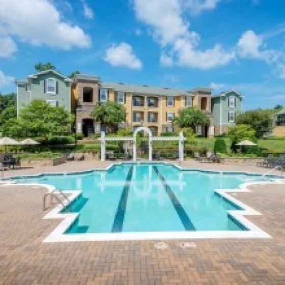 Image of Cottonwood Reserve's Resort-Style Pool with Lap Lane and yellow and teal apartment exterior