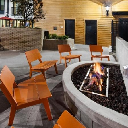 View of Pool Area, Showing Fire Pit Social Space and Outdoor Chairs at Cottonwood Westside Apartments