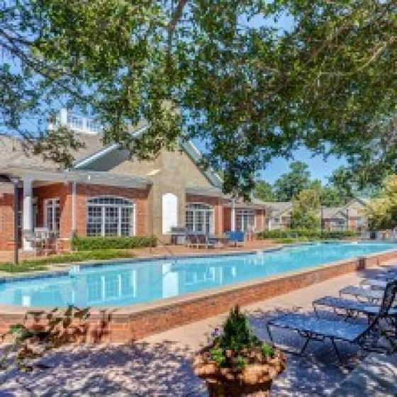 Image of Retreat at Peachtree City's swimming pool, lounge chairs and sitting areas