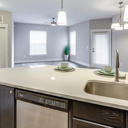 View of Renovated Apartment Interiors, Showing Kitchen With Island, View of Open Living Space, and Built-In Desk at Cottonwood Reserve Apartments