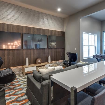 View of Clubroom, Showing Seating Area and Three Flat Screen TV's at Cottonwood Reserve Apartments
