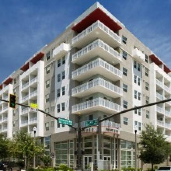 Cottonwood Bayview, white tan building, many levels, balconies, trees, main entrance