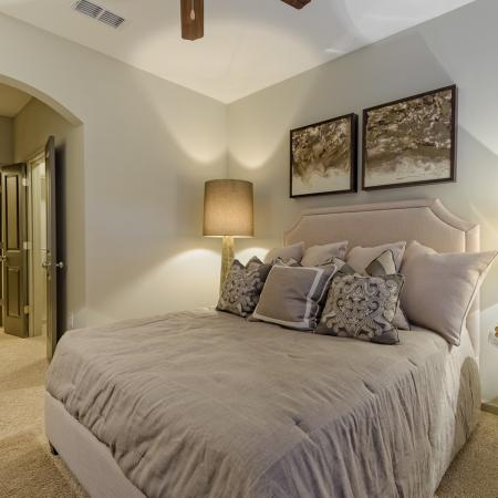 View of Bedroom, Showing Ceiling Fan and View of Bathroom at Heights at Meridian Apartments