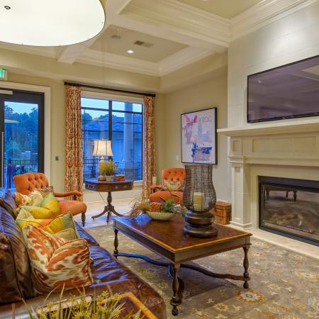 View of Resident Clubhouse, Showing Fireplace, TV, and Seating Area at Heights at Meridian Apartments