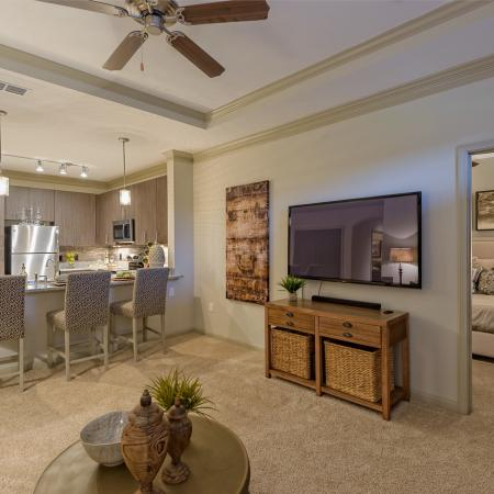 View of Living Room, Showing Ceiling Fan, View of Kitchen and Bedroom at Heights at Meridian Apartments
