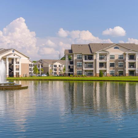 View of Lake, Showing Fountain, Walking Path, and Apartment Buildings at Heights at Meridian Apartments