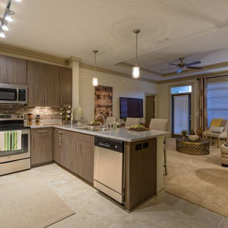 View of Kitchen, Showing Granite Countertop and View of Living Room at Heights at Meridian Apartments