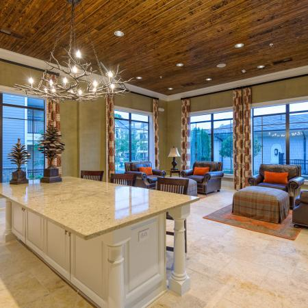View of Resident Clubhouse, Showing Kitchen Island and Seating Area at Heights at Meridian Apartments