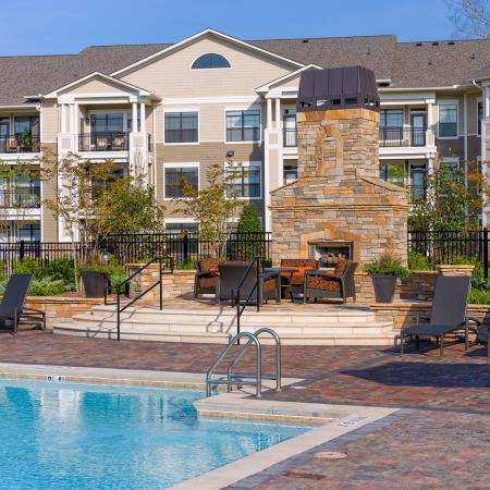 View of Pool Area, Showing Fireplace, Outdoor Furniture, and Loungers at Heights at Meridian Apartments