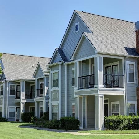 View of Community Exterior, Showing Private Balconies, and Landscaping at Cason Estates Apartments
