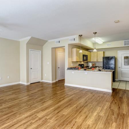 View of Living Room, Showing Wood Plank Flooring, Kitchen With Tile, and Hallway at Cason Estates Apartments