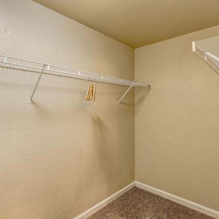View of Walk-In Closet, Showing Carpet, Attached Long Shelving at Cason Estates Apartments