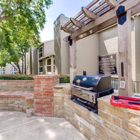 View of Grilling Area, Showing Grill, Pergola, and Brick Bench at The Arbors of Las Colinas Apartments