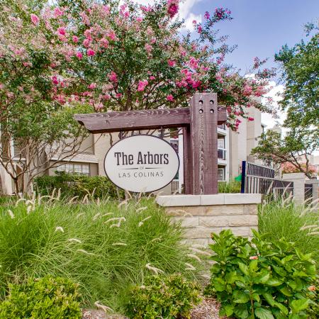 View of Signage, Showing Name of Community and Landscaping at The Arbors of Las Colinas Apartments