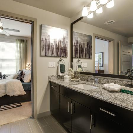View of Bathroom, Showing Single Vanity and View of Bedroom at Routh Street Flats Apartments