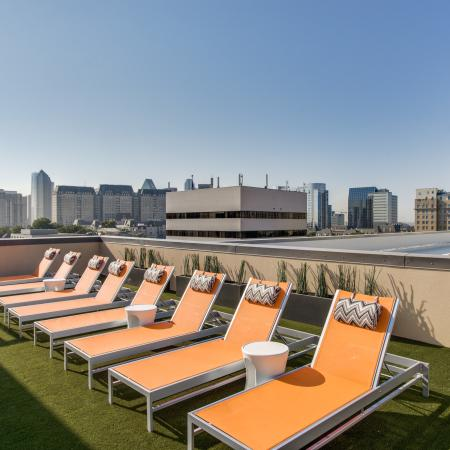 View of Rooftop Lounge, Showing Loungers and Views of Downtown Dallas at Routh Street Flats Apartments