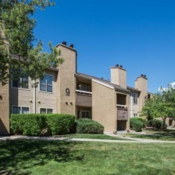 Image of Cottonwood Apartments exterior apartment building showcasing patios and balconies