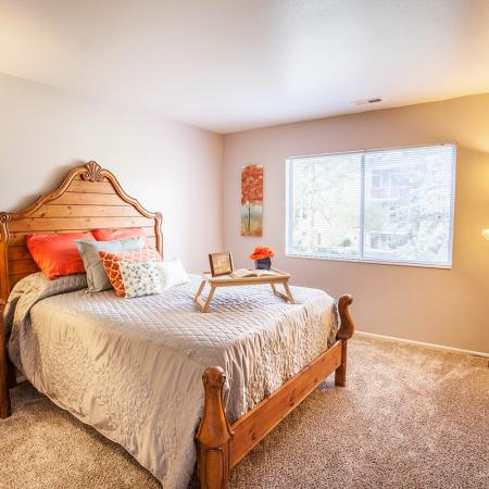 View of Bedroom, Showing Bed, Nightstand, and Window View at Fox Point in Old Farm Apartments