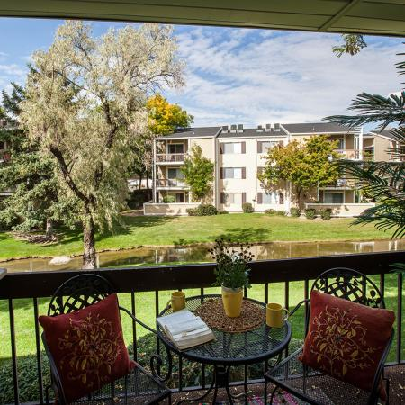 View of Balcony, Showing Outdoor Furniture, Railing, and View of Lake at Fox Point in Old Farm Apartments