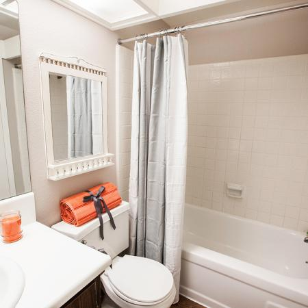View of Bathroom, Showing Single Vanity, Toilet, and Tub at Fox Point in Old Farm Apartments