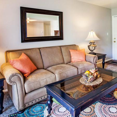 View of Living Room, Showing Couch, Rug, and Door at Fox Point in Old Farm Apartments