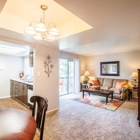 View of Dining Area, Showing Dining Table, View of Kitchen and Living Room at Fox Point in Old Farm Apartments