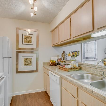 View of Kitchen, Showing Plank Wood Flooring and Gas Appliances at The Regatta Apartments