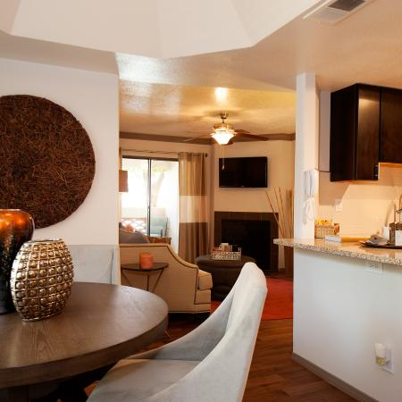 View of Dining Room, Showing Bar Top, Table and Chairs, and View Into Living Room at Pavilions Apartments