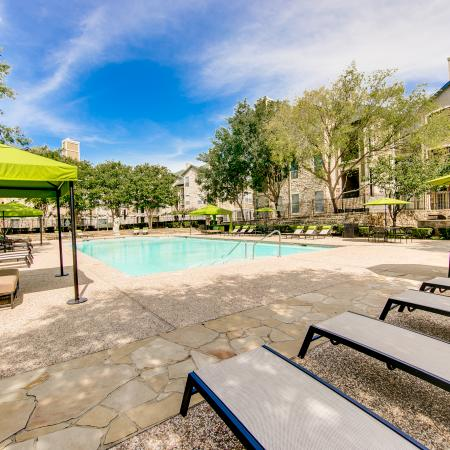 View of Pool Area, Showing Loungers, Cabanas, Picnic Areas, and Fenced-In Area at Stonebriar of Frisco Apartments