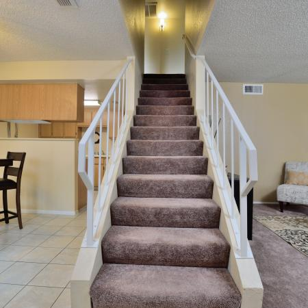 View of Staircase Leading to 2nd Floor, Showing Living Room, Dining Room, and Kitchen at Camelot Apartments